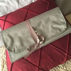 """New hanging Jewelry Roll.  Perfect for Travel! Gold lame fabric jewelry roll.  .  4 zippered pouches. Never used.  24"""" long. 12"""" wide.  3 compartments are 3.5"""" each tall.  Bigger one is 7"""".  Rest is sewing space.   Charming Charlie Jewelry"""