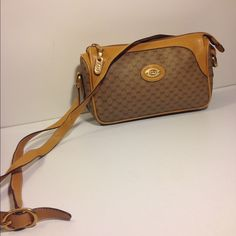 "Gucci Vintage Cross Body Shoulder Bag Gucci Vintage Cross Body Shoulder Bag .... Serial # 001.115.0443 ... Color: Brown ... Material: PVC / Leather ... Length: 10"" ... Height: 6.5"" ... Width: 3.5"" ... Strap drop: 21"" ... Top zippered closure ... Adjustable strap ... Condition: Normal sign of use ... leather edge / interior lining rub ... Guaranteed Authentic Gucci Bags Shoulder Bags"