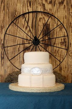 cake with a wagon wheel backdrop