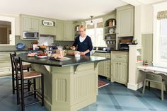 This kitchen was upgraded with a new, 7½-foot island. The existing cabinets and appliances stayed, while the room gained storage, seating, and a more open feel.