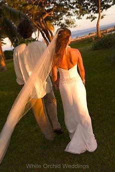 Bride & groom beach front wedding on Maui, Hawaii.