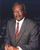 Trevor MacDonald Renowned broadcaster and first UK black TV news anchorman       Born in Trinidad in 1939, Trevor worked in various aspects of the media including local newspapers, radio and television. He joined the Caribbean regional service of the BBC World Service in 1960 as a producer, before moving to London at the end of that decade to work for the corporation (BBC Radio, London).