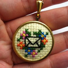 MaMagasin: Envelope and Flowers Necklace in Spring Pastels and Gold #cross-stitch
