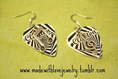 Hypnotic Music Note Guitar Pick Earrings  SEE MORE AT: www.madewithlovejewelry.tumblr.com  https://www.facebook.com/MadeWithLoveJewelryByShana