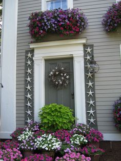 Flowers guard the front door.
