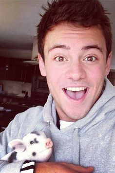 Who's cuter Tom Daley or his micro pig? DUH! The pig!i want the pig more!!!!!!!!!