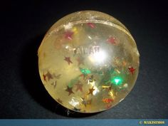 Superballs. I had one exactly like this! I also had them in pink, blue, green, yellow, and orange. One was white with red and blue stars. I loved these things!