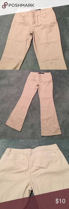 Khaki Flare Jeans Never worn, my mom bought these for me when I first started going to private school but I didn't like them. Pants Boot Cut & Flare