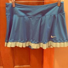 Nike tennis skirt Built in briefs!  Custom fit.  Fits size 12.  Turquoise.  Excellent condition!!!  Thick waistband so feels good around waist Nike Other