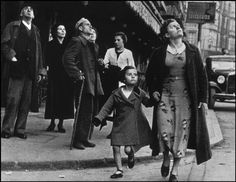by Robert Capa  The Spanish Civil War. - SPAIN. Bilbao. May 1937. Crowds running for shelter as the air-raid alarm sounds. -
