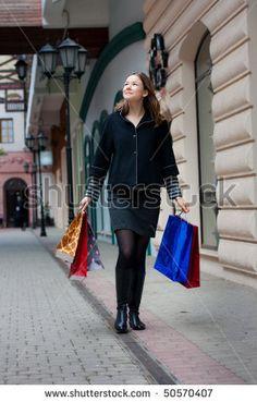 Beautiful Young Woman With Shopping Bags Walking Outdoors Stock Photo 50570407 : Shutterstock