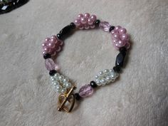 Pink Pearl Bracelet with White Pearl and Black Bead Accents and Gold Heart Clasp by handmadejewelrybypam on Etsy