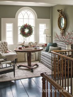 Upholstered pieces dressed in soft neutrals offer a quiet moment on the second floor landing. - Photo: John Bessler / Design: Matthew Patrick Smyth
