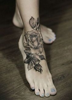 Gray Rose Flower Tattoo On Foot