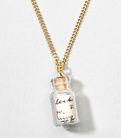 Keep your secrets close to your heart with this simple, mysterious necklace featuring a tiny glass bottle with small secret message rolled up inside. What does it say? We're not telling!