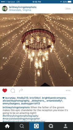 Wagon wheel with mason jars chandelier for Justice & Audrey's wedding reception.