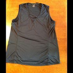 Cute Reebok play dry tank. Very soft Reebok tank with play dry fabric technology.  Size 14/16.  83% polyester and 17% spandex.  Light weight fabric.  Tank has been worn 1-2 times but is in excellent condition.  Top of shoulder to bottom of tank measures 25 inches. Reebok Tops Tank Tops