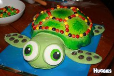I based this cake on my 2 year old boys favourite soft toy turtle that he sleeps with every night. It was a chocolate cake decorated with homemade marshmallow fondant icing. He loves pebbles so had to add these to the shell.