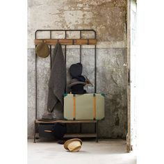 This industrial looking coat rack would look great in any hallway. It has 4 hooks to hang all your coats and a wooden seat to sit on whilst putting your shoes on and a useful storage shelf beneath. It has a metal frame with wood seat Shoe Rack And Coat Hanger, Storage Shelves, Wall Shelves, So Cooc, Free Standing Coat Rack, Door Fittings, Black Shelves, Rustic Wood Walls, How To Store Shoes