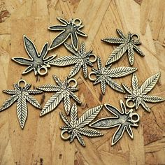 Little Marijuana Leaf Charms Antique Brass Hemp Weed A255 by CharmShopCrafts on Etsy
