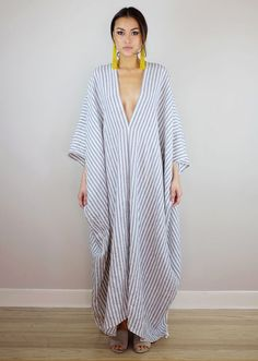 A relaxed, one size linen kaftan with deep v neckline and drop sleeves.Fabric: Plain weave; ...