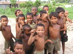 Ujambardi Bangladesh children of rice workers--smiling faces  Photo by Melanie Pratt