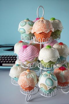 @Kristen Andersen Cupcakes. sew circle to piece of fabric = bottom...sew bottom and top (line of fabric) together at frosting end..leave top of top open to fill with filling...hand sew closed and add pompom [for cherry]