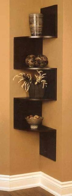 I've seen several variations of these hanging corner shelves available, including ones with inbuilt picture frames. I think the panelled parts against the wall make it more of a feature so it's a nice solution for a small empty corner. It's also an idea that you could easily DIY.