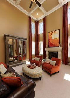 custom, media, cabinet, mirror, great room, family room, two story, drapes, seating, ottoman, green, blue, turquoise, orange, leather, neutral, accessories, traditional, transitional, pillow, art, fireplace, cast stone, mantel, coffer ceiling, floor vase