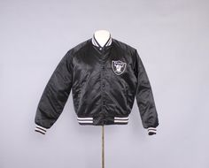 Vintage 80s RAIDERS JACKET / 1980s LA Raiders Black Satin Sewn Letters Chalkline Bomber #vintage #men #menswear #mensfashion #vintagefasion #mens #mensjacket #LA #LAraider #raiders #bomberjacket #80s #80sfashion #NFL #80sjacket #raidersjacket #NWA #Straightouttacompton #comton #california #californialove