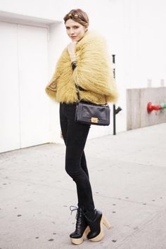 Those shaggy monster coats. Elena Perminova at New York Fashion Week A/W 2012/13