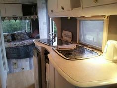 Final shot of caravan revamp from brown beige and terracotta to.white and grey. Love this 2014