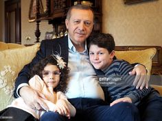 Turkish President Recep Tayyip Erdogan poses for famous Istanbul-based photojournalist Ara Guler with his grandson Ahmet Akif (L) and granddaughter Mahinur (R) at his home in Istanbul, Turkey on December 19, 2015.