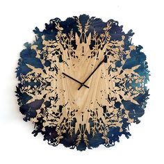 Constructed from oak and birch, the Botanica clock assumes intricate natural shapes while revealing the time. Specifications: Diameter: 60 cm Depth 4 cm Materials: Birch plywood and Oak