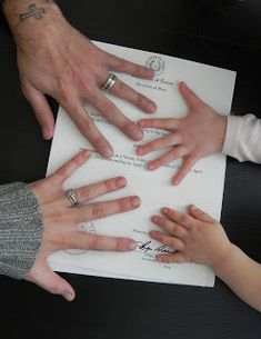 Photo of Hands on Adoption Papers. Someone has to take this picture for us!