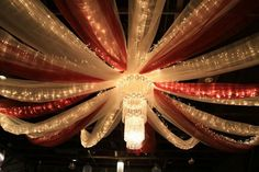 This ceiling drapery can be done with any color tulle to accent your wedding