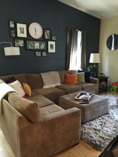 Living Room Sectional Gallery Wall With Clock