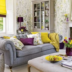 Great neutral grey chesterfield provides relief from the wallpaper and colourful accents