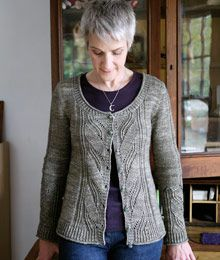 Leaving by Anne Hanson. This scoop-neck, A-line design includes instructions for both the pullover and cardigan variations. A broad panel of openwork leaves is featured at center back and front, and on each sleeve.
