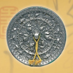 Bronze mirror with motifs of grapes and auspicious animals, Tang Dynasty AD).