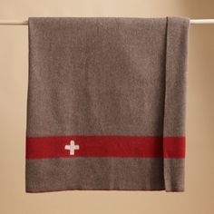 """VINTAGE SWISS ARMY BLANKET--Steeped in alpine tradition and suited to high-altitude elements, our vintage Swiss Army blankets are the real deal—impenetrably warm, pleasingly soft and seamlessly crafted of wool and horse hair. Drawn from recently discovered stock, each blanket is marked with a unique issue number and the signature white cross on a red stripe. Made in Switzerland. 78-3/4""""L x 55""""W."""