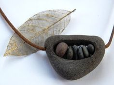 Im thinking large seed pod or walnut shell filled with pretty pebbles???