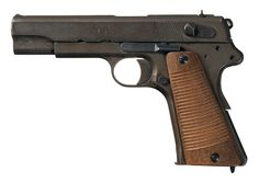 """This is the last of the late """"two-lever"""" VIS Model 35 Radom pistols made under German occupation. It has the three-letter Kennzeichen, or factory code, of """"bnz"""". Note the simple wood grips. (ca. late 1944)"""