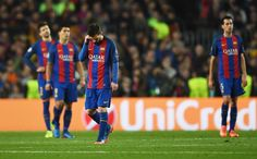 Lionel Messi of Barcelona (3L) and team mates look dejected during the UEFA Champions League Round of 16 second leg match between FC Barcelona and Paris Saint-Germain at Camp Nou on March 8, 2017 in Barcelona, Catalonia.