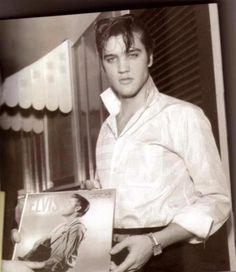 Elvis Presley holding one of his albums :-) so handsome he is