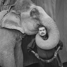 "Mary Ellen Mark: ""I am holding my photograph of Ram Prakash Singh and his beloved elephant Shyama — taken in 1990. Ram Prakash Singh was the ringmaster of ""The Great Golden Circus."" The photograph was done in Ahmedabad India. This was part of my Indian Circus Project."