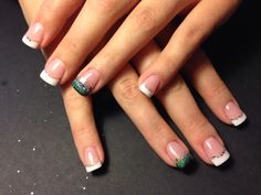 Seahawks inspired French tip accent nail.