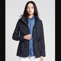 BR navy blue jacket NWT! Banana republic convertible navy field jacket. Great for those rainy days or just as an overcoat jacket!  Has a cute belted waist if your looking for that little extra accent.  A hidden zipped up hoodie for those colder weathers. Size petite small. NWT Banana Republic Jackets & Coats