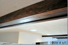 diy faux-wooden beans. I do have a weakness for wooden beams... even if they're fake