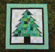 My Kaffe Christmas Tree is finished - in February, of course. I purchased the kit for this mini quilt back in April 2014. I don't know why I...